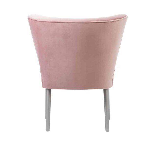 Nowoczesny fotel klubowy w kolorze różu z guzikami, nogi w kolorze srebrnym